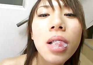 cute oriental girl swallows massive ball cream